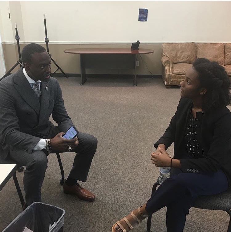 Dr. Yusef Salaam speaking with Rachelle Saint Louis
